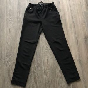 Black stretch waist trousers